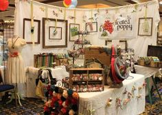 craft fair booth: creative backdrop with hanging frames