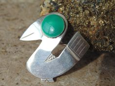 This vintage sterling silver green eyed bird was made in Peru by Graziella Laffi.