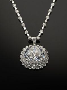 """Idol's Eye"" Diamond with Harry Winston Necklace Object Name: Diamond Date: Diamond: early 17th century, Necklace: mid 20th century Culture: Islamic Medium: Antique triangular modified brilliant-cut light blue diamond"