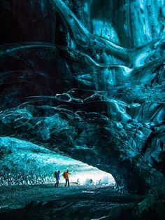 Picture of two ice climbers exiting an ice cave in Iceland