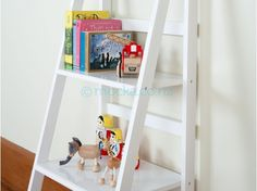 Mocka's Ladder Shelf - White is a stylish and affordable white shelving unit. The funky ladder design will suit any room in the house. Kids Storage Furniture, Shelf Furniture, Nursery Furniture, White Ladder Shelf, White Shelving Unit, Ladder Shelves, Affordable Storage, Affordable Furniture