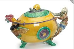 Exceedingly rare yellow-ground Minton Majolica Monkey and Rooster Teapot. Freeman Auctions photo from the Placeholder File of the Majolica International Society Karmason Library.