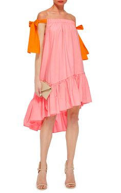 This **MSGM** off the shoulder dress features contrasting self tie bows, hidden pockets and a voluminous ruffle hem.