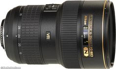 Nikkor 16-35mm f/4 VR. Ken Rockwell says this is the sharpest ultrawide zoom. Only $1200.