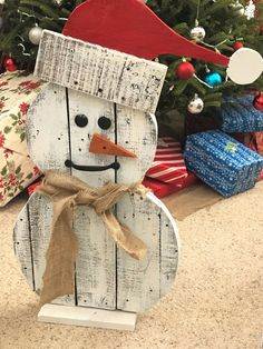 Hand-made Pallet Snowman, featuring a Santa hat. Made from reclaimed pallet wood. The snowman stands about 28 inches tall and features a hinged brace (not shown in picture) on the back so he can stand on carpet, wood floor or on your porch. The one of a kind handle mouth gives him a unique personality. As you walk closer to him, he gives the appearance of smiling more. Pallet wood varies in weight so shipping weights will vary. If you provide me with your zip code, I can give you an accurate…