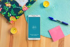 Free Galaxy Note Mock-ups are hard to come by. Created by the team over at Lovely Mockups. Fresh and colourful presentation of a Galaxy Note phone sitting on a table with 2 yellow candles and various other objects.