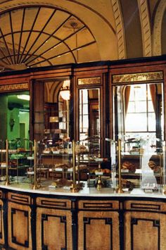 Café Gerbeaud, situated at Vörösmarty tér 7 in Budapest, is one of the greatest and most traditional coffee houses in Europe. Today still, it shines in Gründerzeit style with its stucco, the grand chandeliers, the panelling made of exotic woods and its furniture.