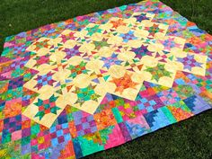 I so love this quilt.  Mom, will you make it for me?  :)