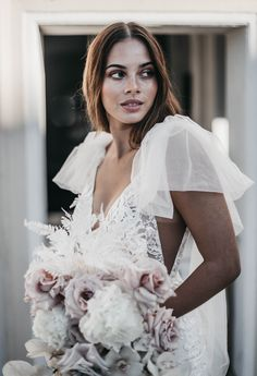 Meet Peony by Emmy Mae. Peony really is what dreams are made of. Her optional tulle bows are perfect for the modern, romantic bride. Tulle Bows, Fitted Skirt, Wedding Looks, Peony, Fashion Photography, Wedding Dresses, Wedding Flowers, White Dress, Flower Girl Dresses