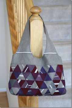 No pattern but this tote is awesome for inspiration.  Click through to see the other side, where she used hexagons.  Made with Oakshott.
