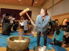 Hit it: Kaoru Nakakuma pounds glutinous rice into a paste - part of the process for making mochi, traditional Japanese rice cakes - at the Nikkei Centre's annual year end celebration. Japanese Rice Cake, Glutinous Rice, Food Staples, Rice Cakes, Traditional Japanese, Mochi, Celebration, Fun, Hilarious