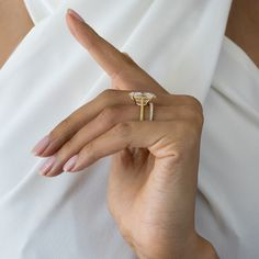 Looking to incorporate color in your ring? Olivia is an elegant custom design, with an 8.50+ carats oval cut set on a yellow diamond pavé and 18k gold band. #jeandousset #bespokejeweler #customring #yellowdiamondring #yellowdiamond #solitaireengagementring #illuminatingyellow #illuminating #ovalengagementring Yellow Diamond Rings, Oval Diamond, Diamond Shapes, Diamond Cuts, Dream Engagement Rings, Dream Ring, High Jewelry, Gold Bands, Colored Diamonds