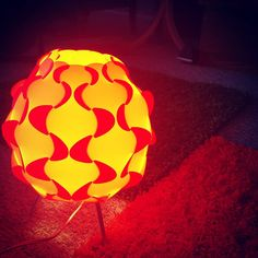 Fun 70s lamp courtesy of Ikea. On top of Orange and Green shag carpet squares. Also from Ikea.