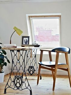 Love the use of the old sewing machine for the legs on the table! And the chair!