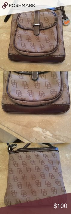 AUTHEBTIC DOONEY & BOURKE Worn, good condition. Some light scratches on bottom leather. Adjustable leather strap. Clean, neat inside. Small front pocket inside zipper pocket. Dooney & Bourke Bags Crossbody Bags