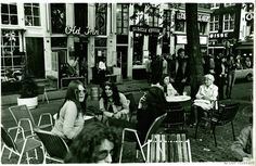 1970's. Terrace at the Leidseplein in Amsterdam. In the background (center) café Old Inn and (right) the Leidseplein Theater movie theater. Photo Dolf Toussaint.  #amsterdam #1970 #Leidseplein