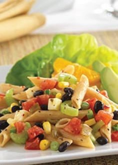 """Try making this refreshing Calico Pasta Salad recipe for dinner tonight! It's a colorful pasta and vegetable salad accompanied with a side of sliced orange and avocado. Can you say, """"yum!""""?"""