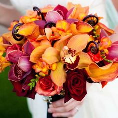 Vivid shades of orange and red, accented with fiddle fern.Photo Credit: Cary Pennington Photography