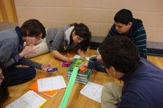 Brewster students experimenting with Newton's Laws.