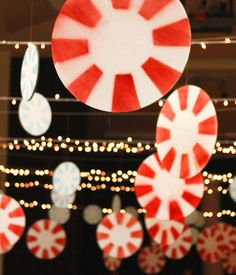 Church Christmas Party . . . they sprayed white paper discs with red paint! Make these with the lights for the pavilion and make them suns with yellow instead!