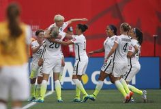 The Americans celebrate after one of Megan Rapinoe's two goals against Australia, June 8, 2015. (USA Today Sports)