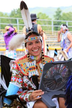 First Place Jingle Dress Champion Erica Issennock figures out a way to stay cool - Cliff Matias