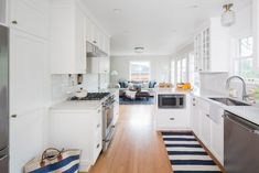 Beautiful, traditional all-white kitchen with quartz countertops and striped accents. Magnolia Kitchen by Distinctive Kitchens Seattle. House, Countertops, Home, All White Kitchen, Kitchen Cabinets, Kitchen, Home Kitchens, Traditional Kitchen, Magnolia Kitchen