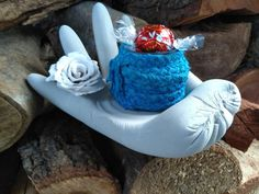 Concrete Crafts - Concrete Hand - this ones holds a clay flower and jar covered with plaited and painted cotton.