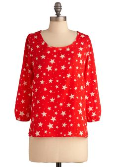 red and white star printed blouse with 3/4 sleeves