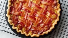 Take all your favorite breakfast ingredients -– bacon, eggs, hash browns, cheese, milk – and combine them into a glorious breakfast pie. Then add a bacon lattice on top and the creation is complete! (Read comments about bacon-DH) Bacon Breakfast, What's For Breakfast, Breakfast Dishes, Breakfast Pancakes, Yummy Breakfast Ideas, Best Breakfast Recipes, Breakfast Casserole, Bacon Recipes, Pie Recipes