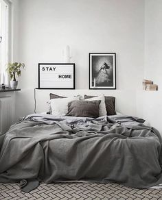 A small and stunning bedroom - love the grey throw
