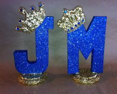 Sparkle letter with crown.  Table numbers can be by glamtastic