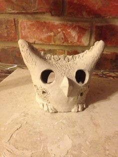 Pottery owl made by throwing a cylinder then working with the clay to make this cute fellow! The back side is a monster face!