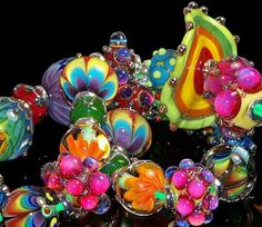 Super bright, super fun. Lots of Double Helix. By Powder Mill Glass on ebay. Enjoy.
