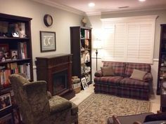 Upstairs Loft/Retreat Remodel: Added can lights, shutters, crown molding, base molding, chair rail molding, fireplace, bookcases, & 2-tone paint.