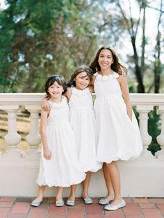 Flower girls in white. Photography: Ryan Ray  - ryanrayphoto.com/