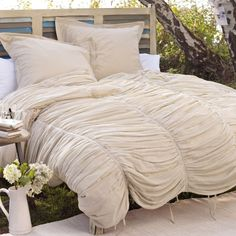 Love the texture and lines of this comforter.  looks delicate and soft yet not too prissy.  might be the perfect one?