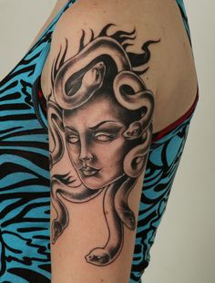 This is my tattoo of Medusa, the photo was taken an hour after it was finished. I apologize for the little bit of bleeding you can see in her eyes. The tattoo was done by an artist named Chad. He had a shop called Heavy Hitters in Olean, NY. He has closed shop and moved since this was done. I'm not sure where to.