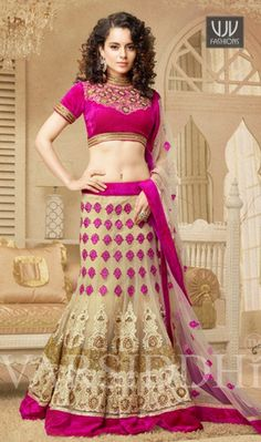 Kangana Ranaut Cream And Pink Net Lehenga Choli Kangana Ranaut cream and pink net lehenga choli with embroidery, resham, zari, lace and patch border work. As shown an matching choli and net dupatta comes with this.