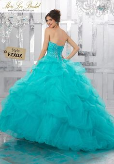 Style FZXOX Rhinestone and Crystal Beading on a Ruched Tulle Ball Gown  Beautiful Quinceañera Dress Featuring a Tulle Pick-up Skirt with Delicate Beading. A Beaded Sweetheart Bodice Completes the Look. Matching Bolero Jacket Included. Colors Available: Blush, Capri, Fuchsia, White
