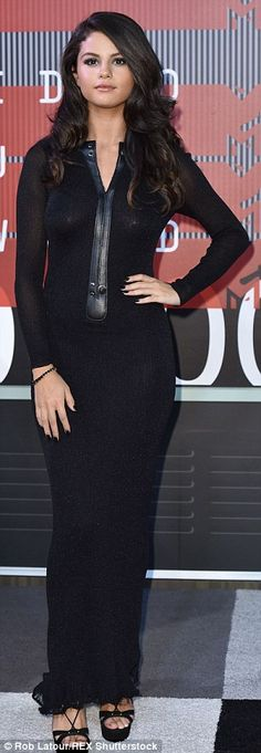 Sexy Selena: Miss Gomez kept things relatively low-key in a glittering black maxi dress by...