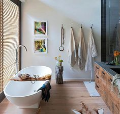 So casual and obviously a great family bathroom and yet the white and pale wood lend a chic tone to the room.