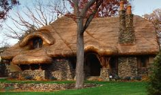 Storybook Cottage -- laid in a wave pattern and rolled under at the eaves. www.customshingles.com