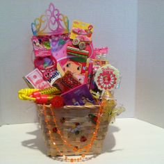 Kids Gift Basket Pretty Basket for a Pretty Girl~Vera Mae Collection (Ages 4 to 8)  Strawberry Short Cake Big Fun Book To Color Jump Rope Strawberry Hair Brush Strawberry Hair Accessories (8) Disney Crayon Gummy Band Candy Light -up Ring  (1) Ice Cream Lip-Gloss Play Flake Money  Tiara Necklace on the Basket is Removable Chocolate Chip Cookies Ring Pop 3 Pack Set Bottle Pop Lip Gloss Candy Bracelet and Watch (4) Disney Bracelets