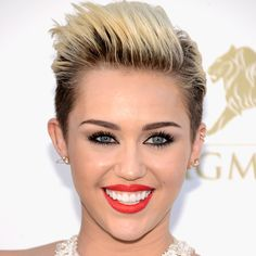 Miley Cyrus goes for a pretty punk hair and makeup look at the 2013 Billboard Music Awards. Love it or leave it?