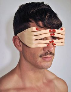 Jeremy Scott Flesh Hands frame BY Georgio   Flesh with red nails acetate frame with no lens.   $258. Cool