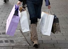 Image: A woman carries shopping bags 2014... STOP SHOPPING!