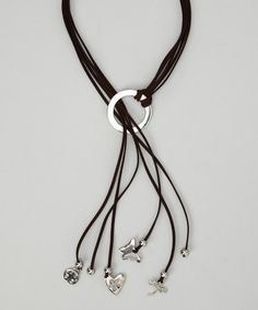 Soft suede cords and a variety of silver-plated charms craft this statement accessory.