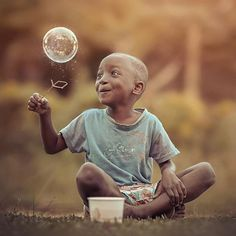 "#magical #moment by @lexonart ""Adoration"" Beauty is in the eyes of the beholder for even a bubble can be the most beautiful thing in the world to a child. #photography #childrenphoto #child #playful #playing #happy #beautiful #world #eyes #laughter #jamaica #color #tones #moment #featuremeofh #cooloceann #featuremeval #bleachmyfilm #ftwotw #tangledinfilm #ig portrait #ig muse #art #artpiece #ourchildrenphoto #love #ig papua #creative #photographer"