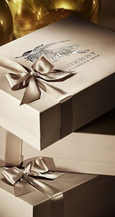 Elegantly Beribboned Burberry Boxes - Monochromatic color palettes add sophistication to any gift wrapping #giftwrap